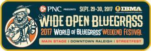 Illustration of Sir Walter Raleigh playing a banjo. PNC presents Wide Open Bluegrass, Sept. 29-30, 2017 (IBMA logo in upper right corner.) 2017 World of Bluegrass' Weekend Festival. Main Stage; Downtown Raleigh; StreetFest