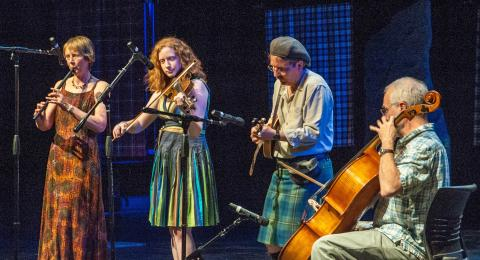 Rip the Calico: Alison Arnold on whistle; Mairead Brady on fiddle; Tyler Johnson wearing a kilt and playing mandolin; Gordon Arnold, sitting and playing cello.